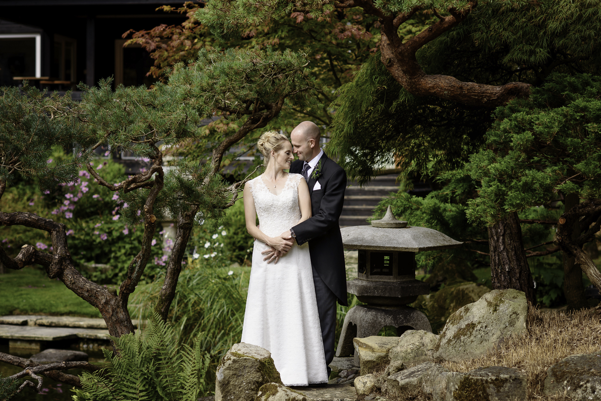 bride and groom in a japanese garden