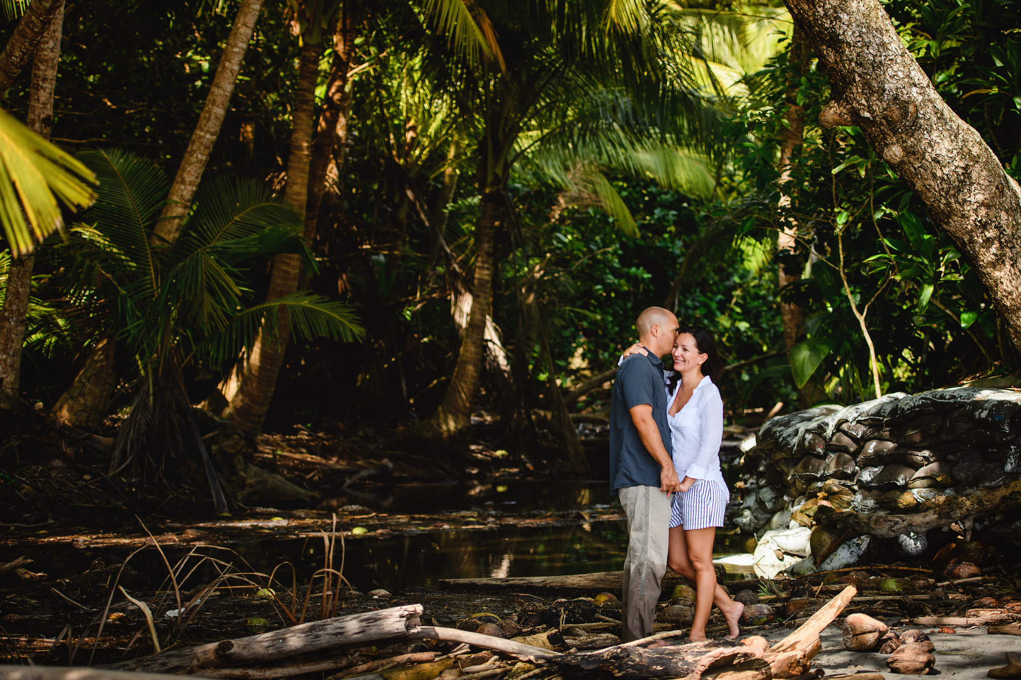 wide angle photo of a couple in a rainforest